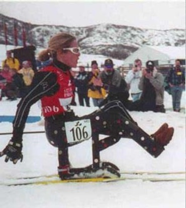 Ski-bike for cross-country skiers with paraplegia
